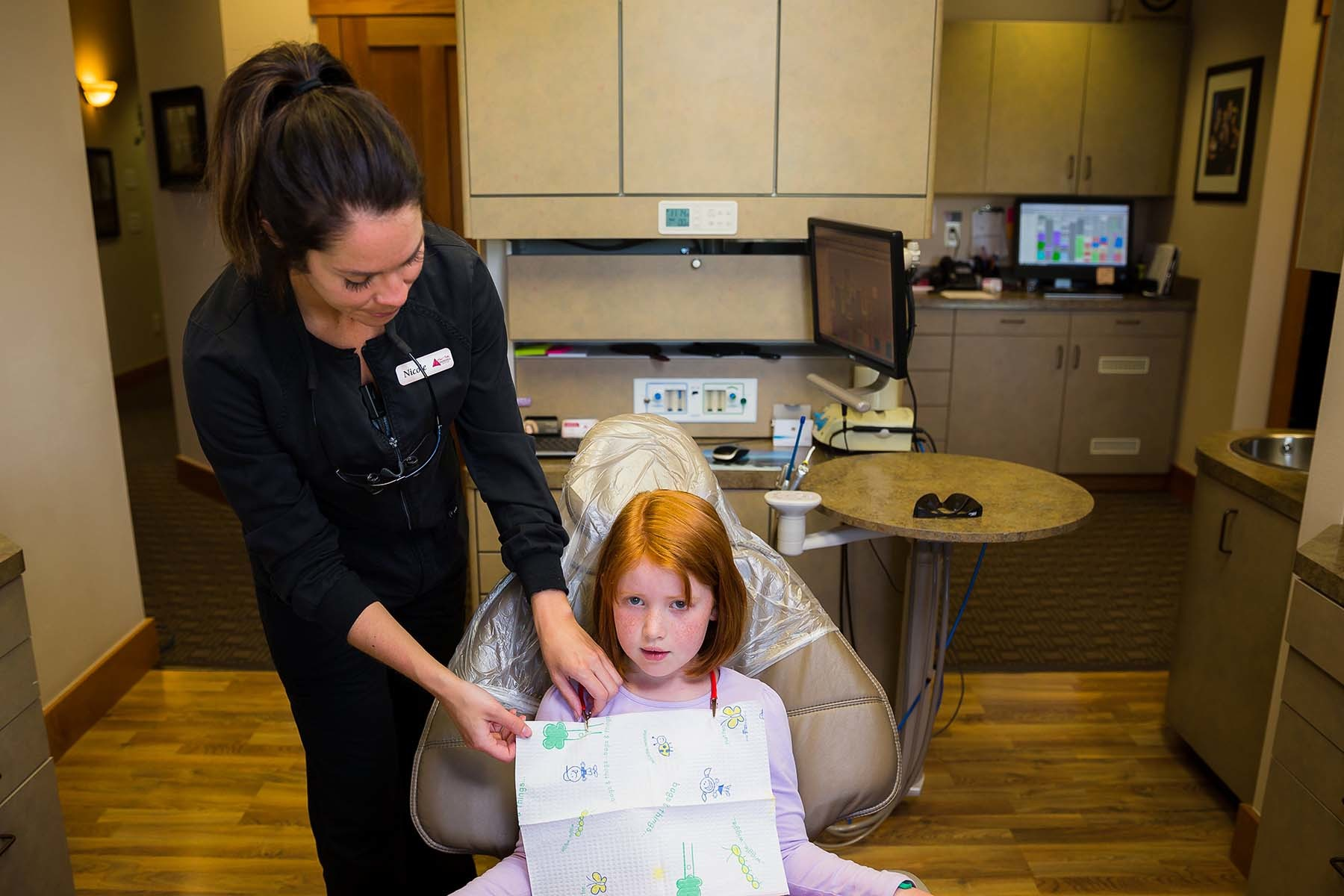 Nicole Helping A Child With Dental Exam