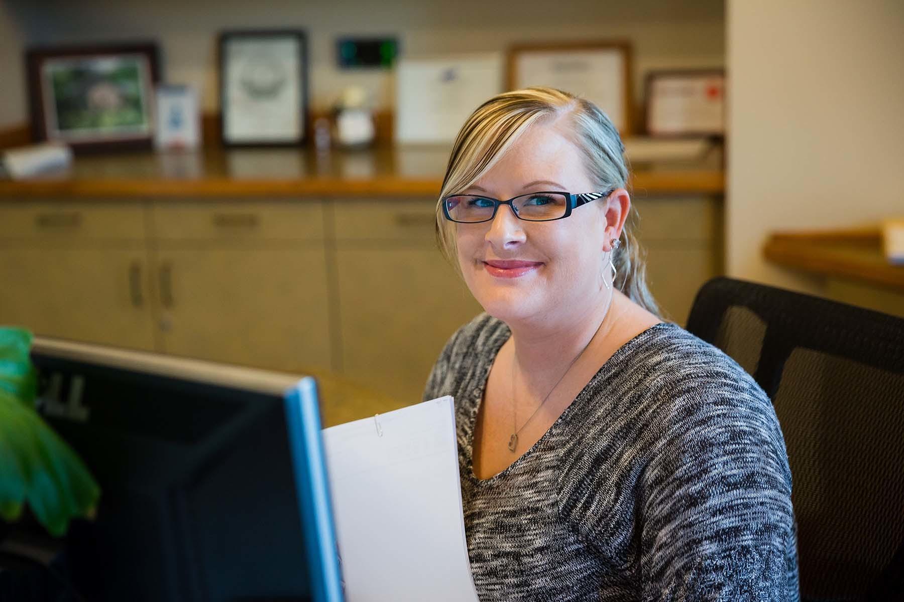 Secretary Smiling In Office